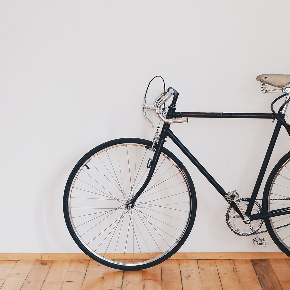 Minimalistic bike in fron of a wall